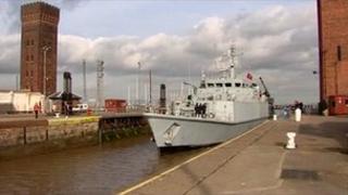 HMS Grimsby entering the port