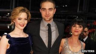 Cast members Robert Pattinson (C), Christina Ricci (R) and Holliday Grainger pose on the red carpet to promote the movie Bel Ami at the Berlinale International Film Festival in Berlin on Friday