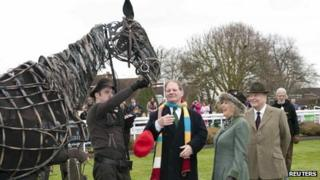 Duchess of Cornwall with a puppet from War Horse at Sandown Park