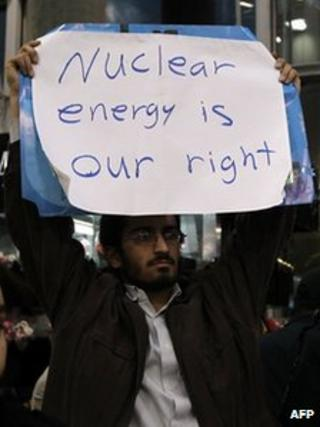 Iranian student protests at Tehran airport on 29 January 2012 as inspectors from the UN nuclear watchdog, the International Atomic Energy Agency (IAEA), arrive for talks