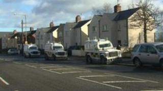 Police searches in west Belfast