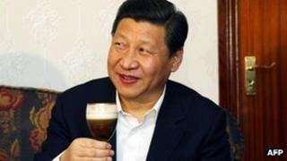 Xi Jinping tries an Irish coffee during a visit to the Lynch Farm at Sixmilebridge, Ireland, 19 February 2012