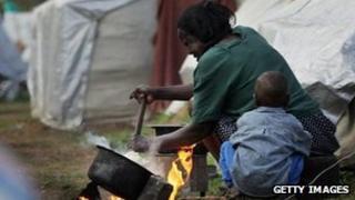 A Kenyan woman prepares ugali