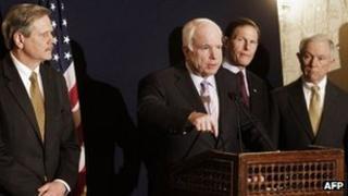 Senator John McCain speaks to reporters in Cairo, Egypt, 20 February 2012