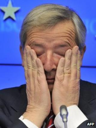 Luxembourg Prime Minister and Eurogroup president Jean-Claude Juncker rubs his eyes at a news conference in Brussels, 21 February