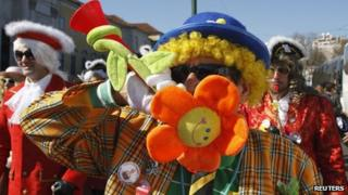 Carnival revellers protest against Portugal's Prime Minister Pedro Passos Coelho, who cancelled the Carnival national holiday, in Lisbon (18 Feb 2012)