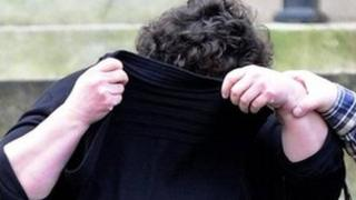 Helen Ryan hides her face at a previous court appearance