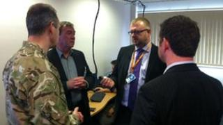 Malvern Cyber Security Group show the military adviser to UK Trade and Industry around the lab