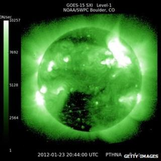 A solar flare erupts from the sun. January 23, 2012.