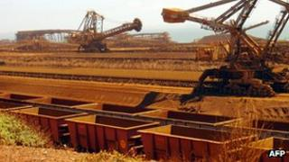 Stackers and reclaimers moving iron ore at a mine in Australia