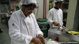 Santosh Pataria mixes a dish in Gateway Hotel kitchen in Khajuraho, India