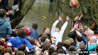 Players during the Royal Shrovetide Football match in Ashbourne, Derbyshire