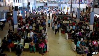Travellers stranded in Tacna bus terminal in Peru near the border with Chile