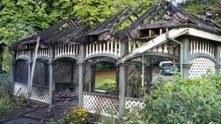 Fire-damaged tea house at Belle Vue Park, Newport