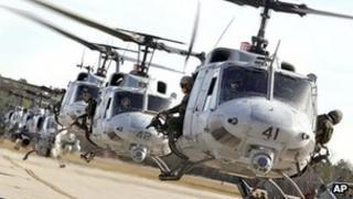 Cobra and Huey helicopters return to North Carolina, 3 February 2012 (file pic)