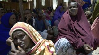 Somalis queue at a food aid distribution centre in Mogadishu