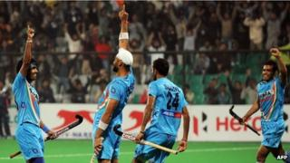 Teammates congratulate Sandeep Singh of India (2nd L) after scoring from a penalty corner during the men's field hockey match between India and Canada of the FIH London 2012 Olympic Hockey qualifying tournament at the Major Dhyan Chand National Stadium in in New Delhi on February 22, 2012.