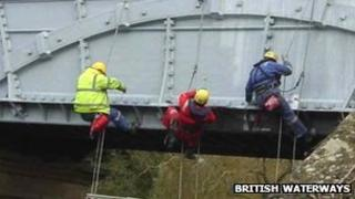 Abseilers at work on the Iron Trunk Aqueduct