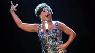 Dame Shirley Bassey performing