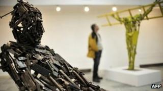 A sculpture made of parts from old weapons is presented at the Kosovo Gallery of Arts during an exhibition by Albanian artist Ismet Jonuzi in Pristina, 21 February