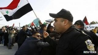 Syrian opposition protesters clash with police outside talks in Tunis. 24 Feb 2012