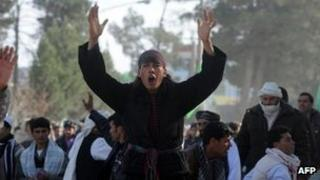 Afghan demonstrators shout anti-US slogans during a protest against Koran desecration in Herat on 24 February