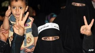 Yemeni women and children celebrate the end of the former regime in Sanaa. 22 Feb 2012