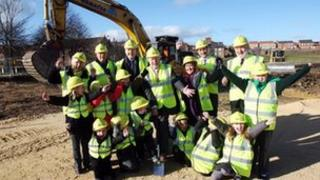 School children joined council officials for the sod cutting ceremony
