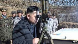 Undated image from KCNA news agency shows Kim Jong-un inspecting a military unit