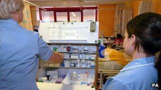 Nurses dispensing medication