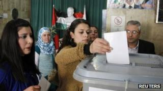 Syrians vote during a referendum on a new constitution