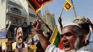 A supporter of Sri Lanka's President Mahinda Rajapaksa protests against the Geneva meeting
