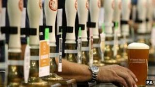 Barman serves pint