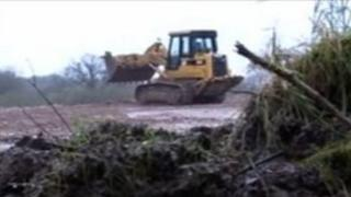 Digger at Strashleigh Hams where rubble was dumped