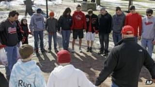 A group of students pray for the victims of a high school shooting in Chardon, Ohio 28 February 2012