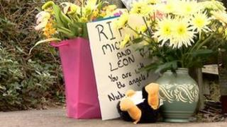 Tributes left at house where the bodies of a woman and child were found