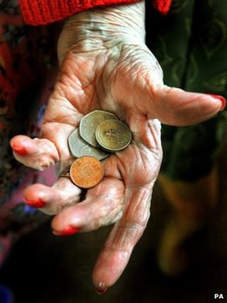 hand holding coins