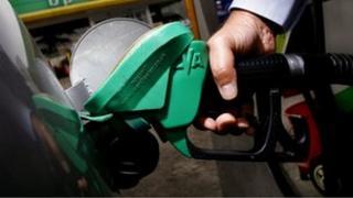 man refuelling car