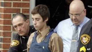 TJ Lane is escorted out of an Ohio courthouse after his arraignment on 28 February 2012