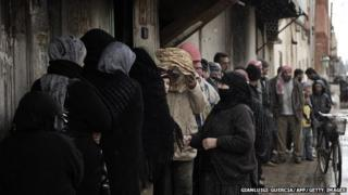 People queue for food 9 miles from Homs