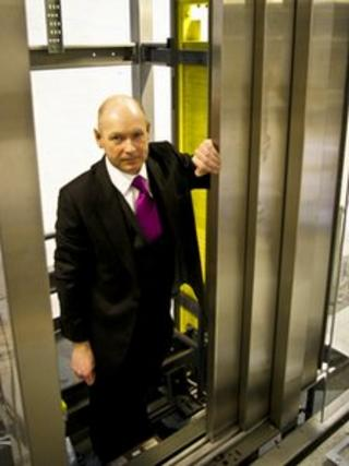 Consult Lift Services managing director Colin Edgar standing in a lift