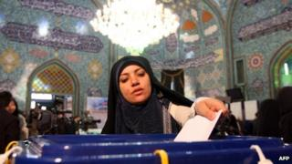 A woman votes in a mosque in Tehran, 2 March 2012
