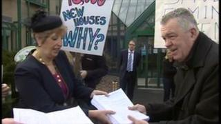 A petition is handed to Councillor Rosalind Prowse