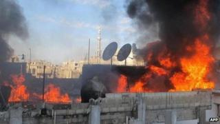 An image released by Syrian activists allegedly showing a building on fire in Baba Amr