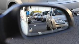 Reflection of traffic in a car wing-mirror