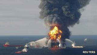 Fire boat response crews battle the blazing remnants of the offshore oil rig Deepwater Horizon, off Louisiana