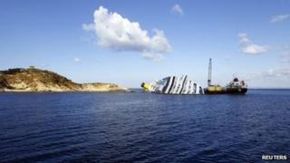 Oil recovery vessels work beside the wreck of the Costa Concordia at Giglio Island, western Italy, 15 February