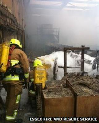 Firefighters using foam at Tilbury power station