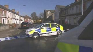 Police officers near the scene of the alleged assault in Canton, Cardiff