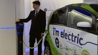 Man charging electric vehicle at the new SSE facility in Glasgow